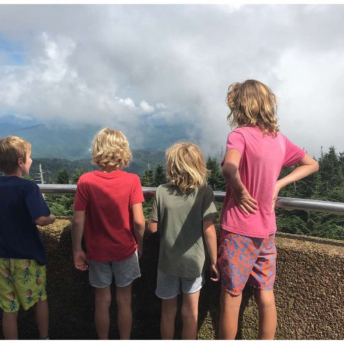Kids looking out. At 6,643 feet, Clingmans Dome is the highest point in the Great Smoky Mountains National Park.