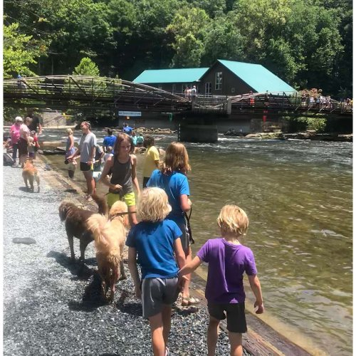 Playing by the water at the Big Wesser Riverside Pub at the Nantahala Outdoor Center in Bryson City, North Carolina.
