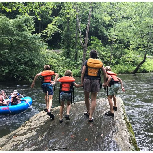 Making the jump on our family friendly whitewater rafting experience on the Nantahala River in Bryson City, North Carolina.